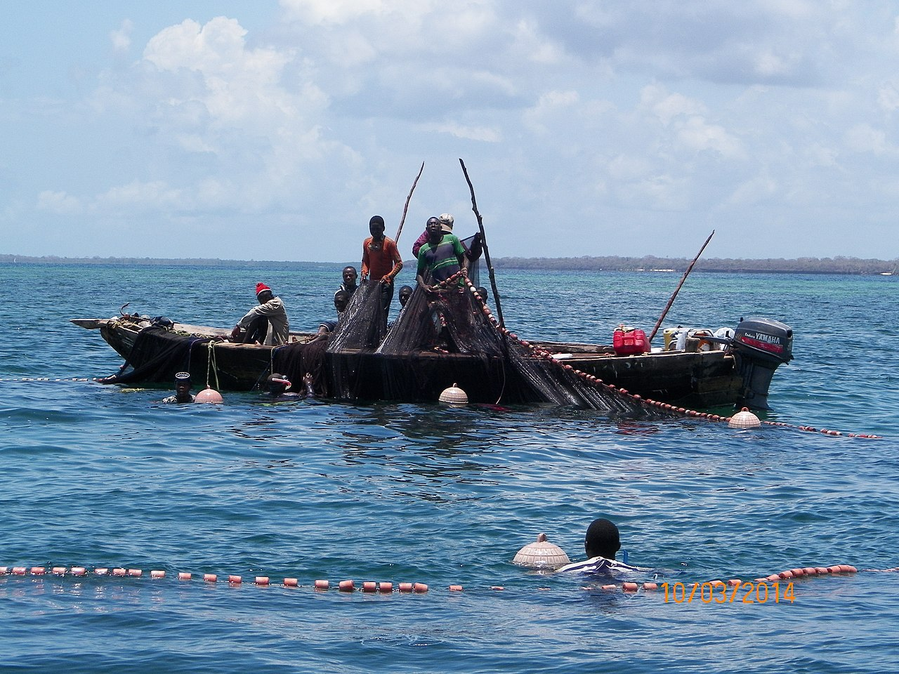 Fishermen using ring nets, which can damage the coral